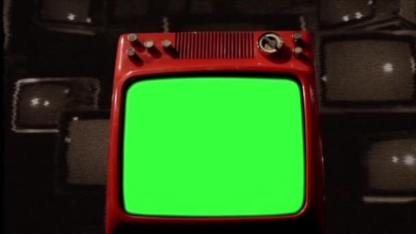 Antik TV zöld képernyővel régi TV-k felett. Statikus zaj háttér. Szepia Tone.
