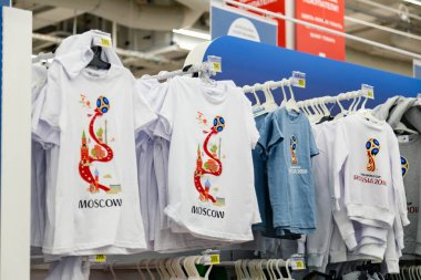 MOSCOW, RUSSIA - June 2, 2018: Official licensed products of FIFA World Cup 2018 Russia #worldcup in the stores of Auchan shop. Souvenirs with the symbols of the Championship mundial. Gift t-shirt