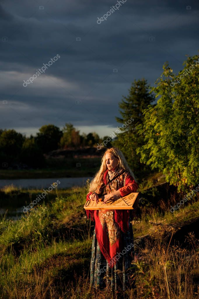 Portrait of a girl playing the gusli in Rabocheostrovsk, Republic Kareliya.