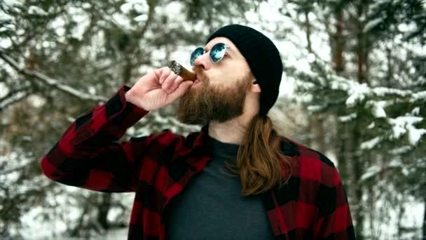 Smoking bearded man