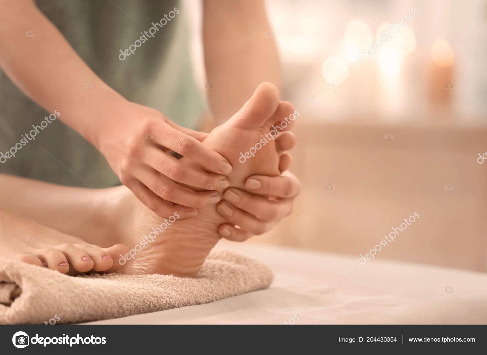 Baby Foot De Salon beautiful young woman receiving foot massage spa salon