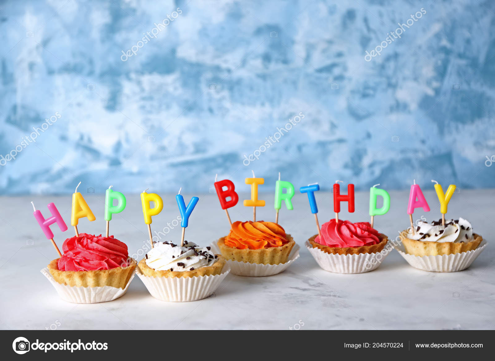 Colorful Birthday Cupcakes Candles Table Stock Image