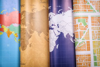 Different world maps, closeup. Travel concept