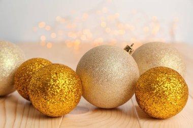 Christmas balls on wooden table