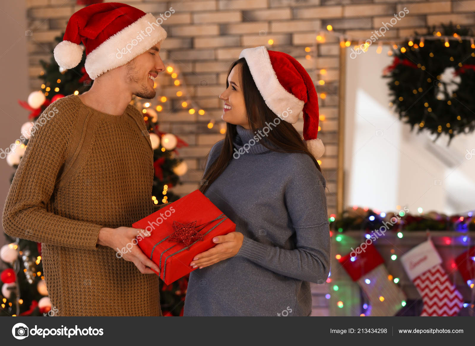 Cute Young Couple Christmas Gift Home — Stock Photo © serezniy ...