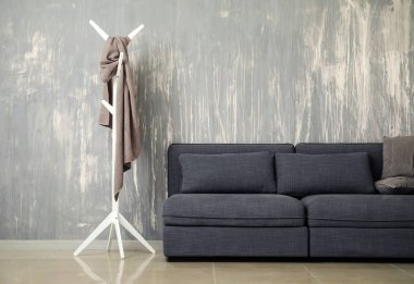 Stylish interior of room with comfortable big sofa