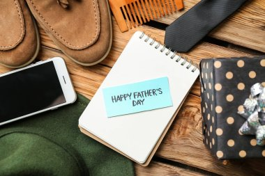 Composition for Father's Day celebration on wooden background