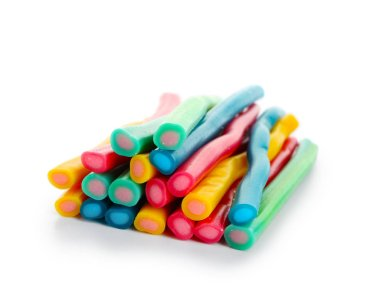 Sweet candy sticks on white background