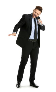 Handsome male singer with microphone on white background