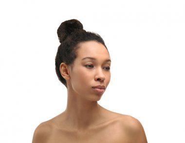 Young African-American woman on white background