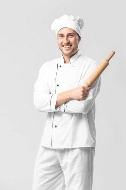 Handsome male chef on white background