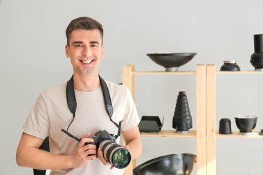 Male photographer in modern studio