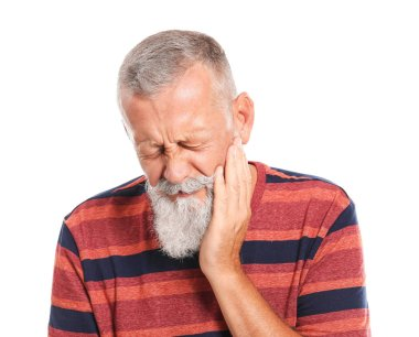 Senior man suffering from toothache against white background