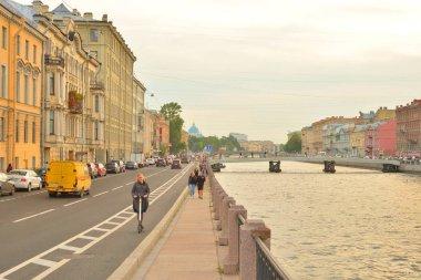 ST.PETERSBURG, RUSSIA - 11 SEPTEMBER 2018: Embankment of Fontanka River in St. Petersburg, the channel of the Neva River delta.