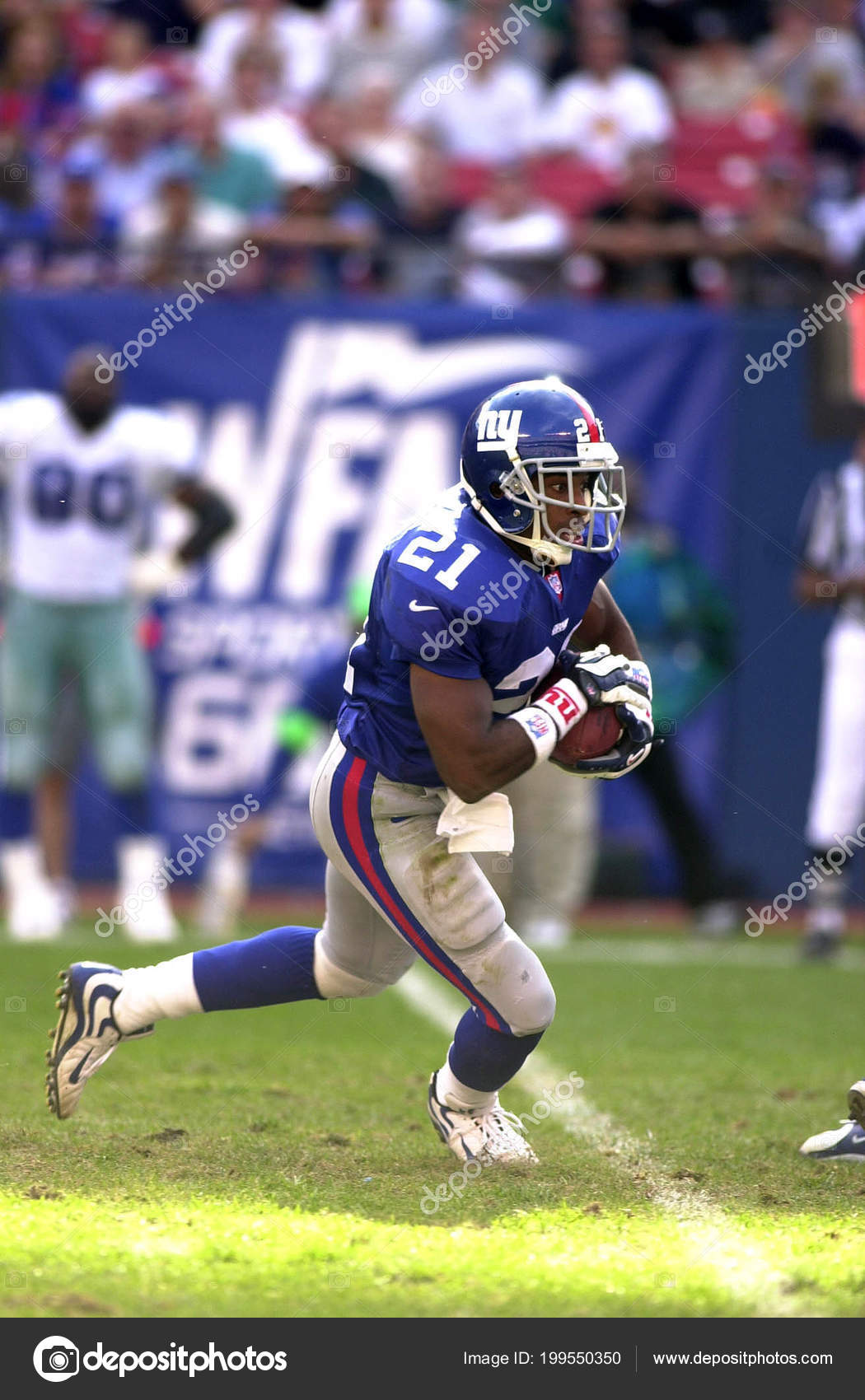 ffb700ce37d Tiki Barber running back for the New York Giants in game action during a  regular season game. Tiki Barber is a former professional American football  player ...