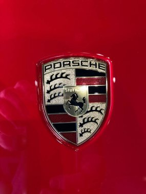 New Porsche car dealership selling cars in a Gilbert Arizona location in the Southwest part of the United States. Porsche AG is a German automobile manufacturer specializing in high-performance sports cars and SUVs.