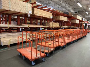 Home Depot is the largest Home Improvement Retailer in the United States. The painting department with a variety of paints and supplies being sold for customers to buy. Photo was taken in Gilbert Arizona located in the South West section of the US