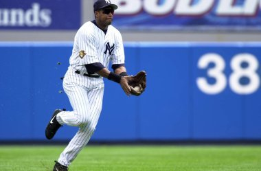 Bernie Williams outfielder for the New York Yankees in game action during a regular season game. Bernie Williams former professional baseball player and musician. He played his entire 16-year career in Baseball with the New York Yankees.