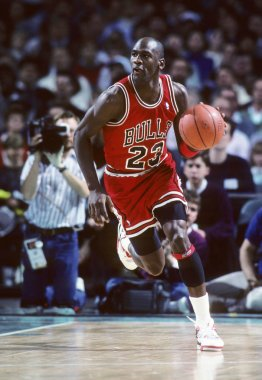 Michael Jordan Hall of Fame player who played for the Chicago Bull in game action during a regular game, He played 15 seasons in the National Basketball Association for the Chicago Bulls.