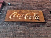 Old Vintage Coca Cola Sign on the outside on a wall of Restaurant showing a price of a bottle of Coke Cola for Five Cents. This photo was taken in downtown Gilbert in Arizona in the Southwest part of the United States.