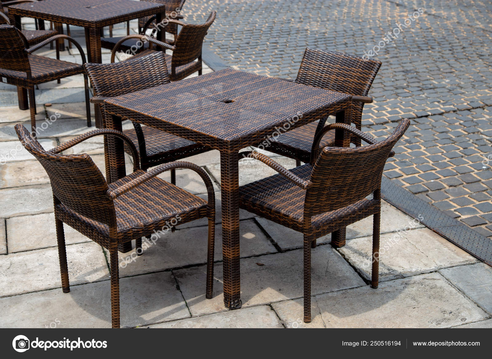 Empty Rattan Tables And Chairs Stock Photo Liewluck