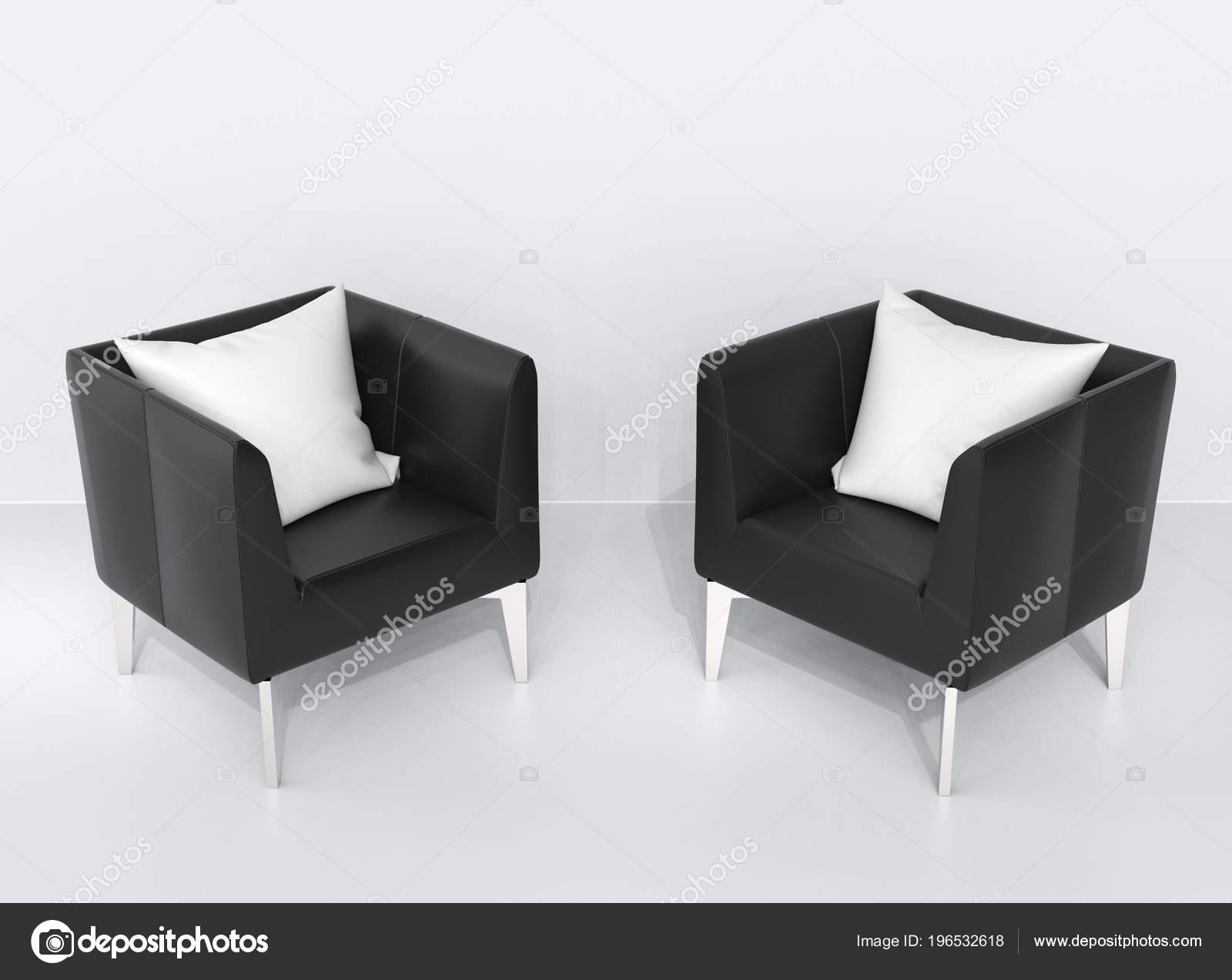 Due poltrone pelle nera con cuscini bianchi top vista u foto stock