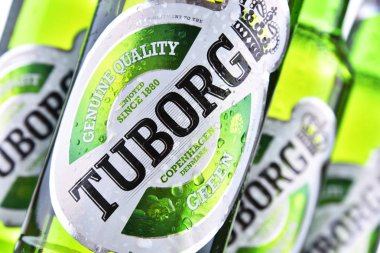 POZNAN, POL - JUN 8, 2018: Bottles of Tuborg beer, produced by a Danish brewing company founded in 1873 near Copenhagen