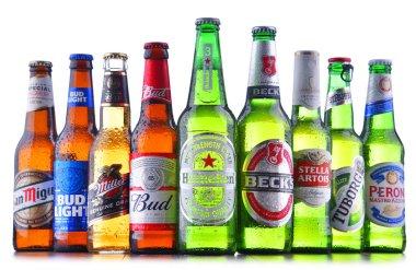 POZNAN, POL - JULY 19, 2018: Bottles of famous global beer brands including Heineken, Bud, Miller, Tuborg, Becks, Stella Artois, Peroni and San Miguel