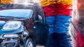 Fotografie Car going through an automated car wash machine.