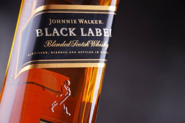 POZNAN, POL - SEP 27, 2018: Bottle of Johnnie Walker, the most widely distributed brand of blended Scotch whisky in the world with sales of over 130 million bottles a year.
