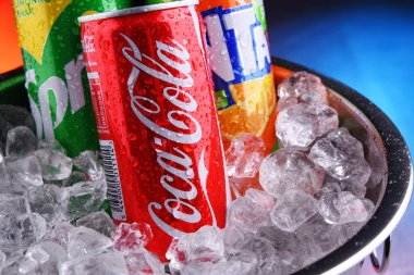 POZNAN, POL - MAY 15, 2020: Cans of Coke, Fanta and Sprite, the flagship brands of Coca Cola Company, American multinational beverage corporation,  headquartered in Atlanta, Georgia, USA
