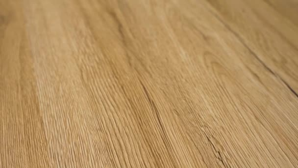 Closeup of the newly installed hardwood floor. Wood floor is in the clear natural color finish