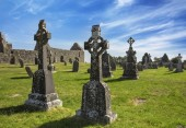 Clonmacnoise Cathedral  with the typical crosses and graves. The monastery ruins. Ireland