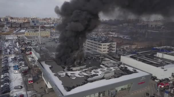 Saint-Petersburg - March 28 2018   Building of motor show on fire  aerial  view  the firefighters extinguish a large fire the building