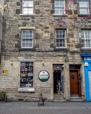 EDINBURGH, SCOTLAND - JULY 30: Buildings and shops on Rose Street in the New Town on July 30 2017 in Edinburgh, Scotland. The famous New Town is a main shopping area of Edinburgh.