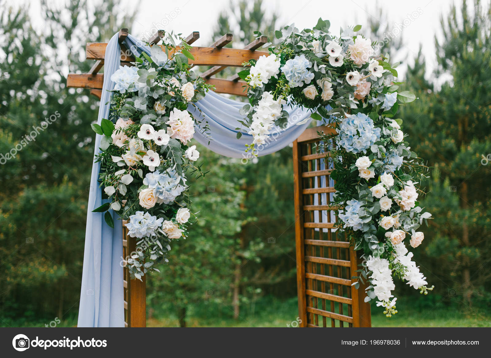 Rustic Wedding Arch.Floral Arch Blue Cloth Wooden Elements Rustic Wedding Ceremony