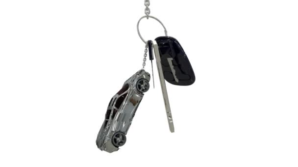 Animation of rotation keys with trinket like car. Keys from a new car with alarm remote. 3D rendering on white background