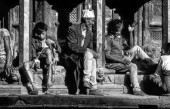 unidentified nepalese people enjoy sitting at the main temp