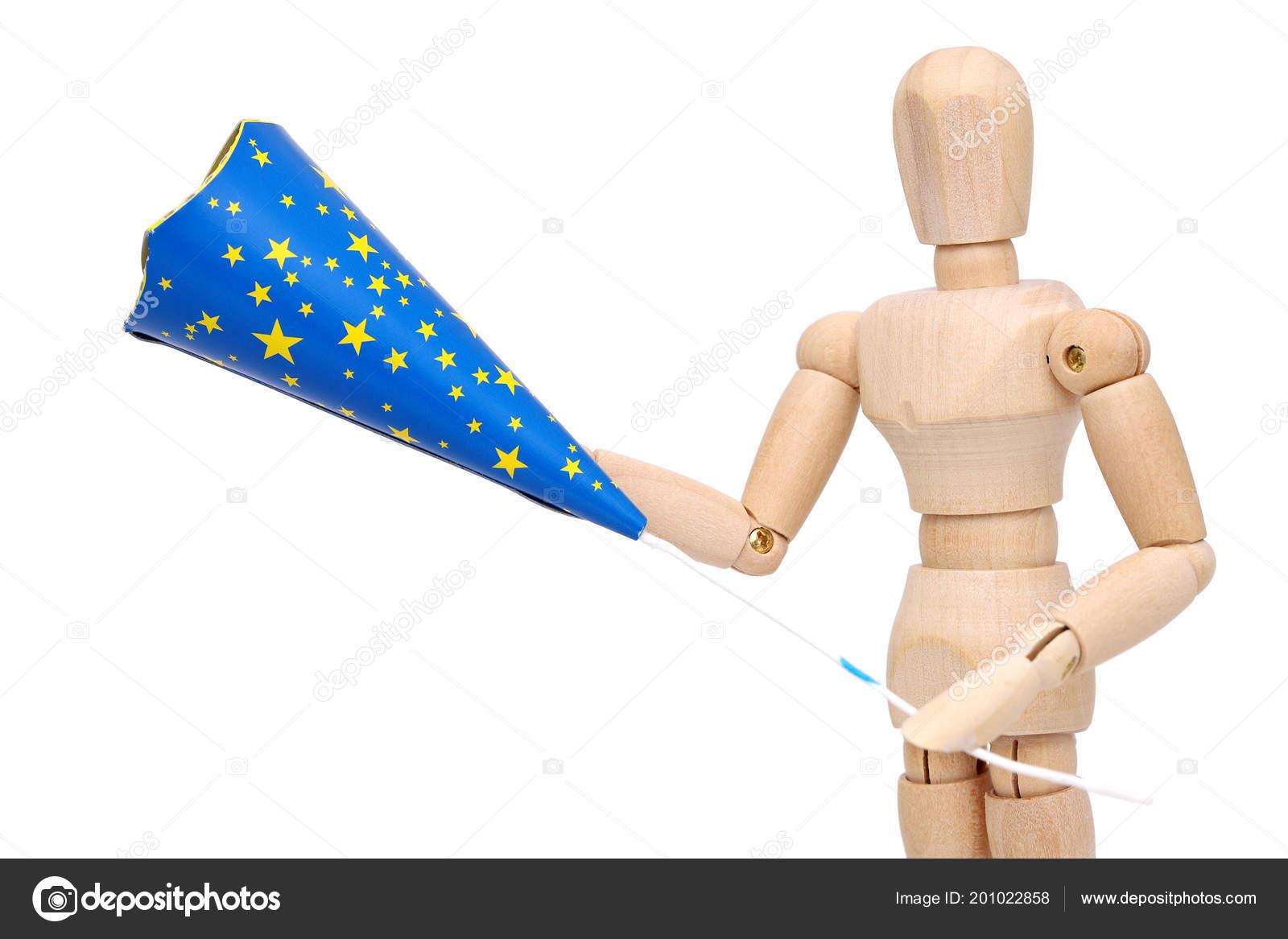 wooden dummy pulling cracker new year day isolated white background stock photo