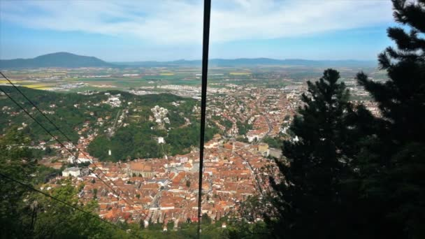 Cable car descending from Tampa hill revealing Brasov City, Romania