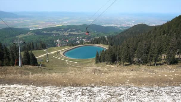 Cable car and lake viewed from Postavaru peak, Brasov, Romania, 4K