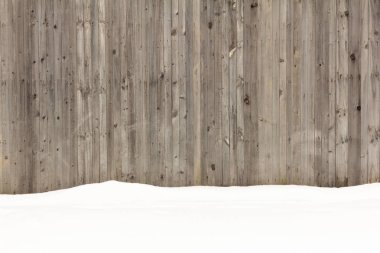 white fluffy snow on wooden fence background