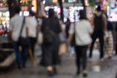 Blurred image of people walking in the street of Shibuya