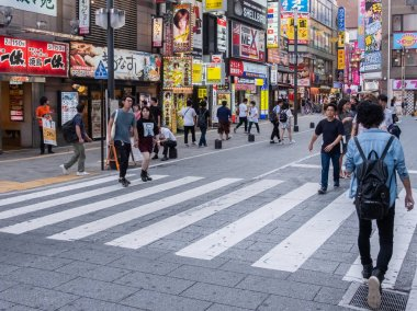 TOKYO, JAPAN - JUNE 30TH, 2018. Crowd of tourists and locals walking in the street of Kabukicho, Shinjuku.