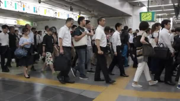 TOKYO, JAPAN - JUNE 30TH, 2018. Commuters walking thorught the automatic ticket gate at Japan Railway Shinjuku Station.