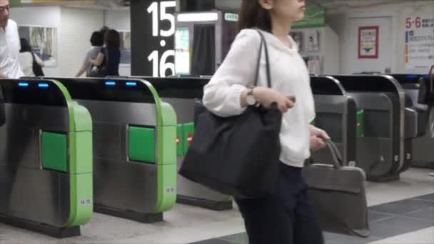 TOKYO, JAPAN - JUNE 30TH, 2018. Commuters walking thorught the automatic ticket gate at Japan Railway Shinjuku Station.