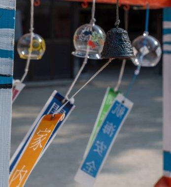Hanging bells in asian shrine