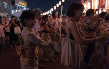 TOKYO, JAPAN - AUGUST 12TH, 2018. Crowd of people dancing at the Bon Odori celebration in Shimokitazawa neighborhood at night.