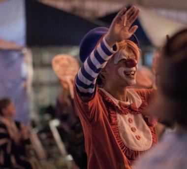TOKYO, JAPAN - AUGUST 12TH, 2018. Man dressed as clown dancing at the Bon Odori celebration in Shimokitazawa neighborhood at night.