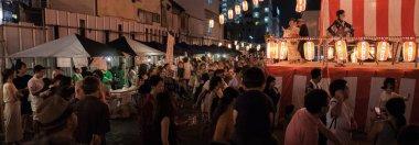 TOKYO, JAPAN - AUGUST 12TH, 2018. Crowd of people at the Bon Odori celebration in Shimokitazawa neighborhood at night.